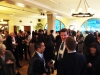 The hall is set abuzz as attendees mingle and move at the Manhattan Penthouse in New York City.